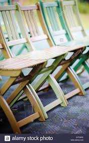 Folding Wooden Outdoor Chairs At A Wedding Reception Stock Photo ...
