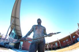Lumberjack statue outside the Union Our Campus