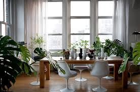 Posh Industrial Dining Room With Ample Natural Greenery Design Studio Recreation Inc