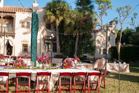 Outdoor Wedding Reception With Cherry Wood Folding Chairs