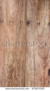 Wooden Background Of Weathered Distressed Rustic Wood With Faded White Paint Showing Woodgrain Texture 675873700