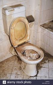 toilet in a neglected apartment stock photo alamy