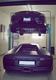 Caption This Two Luxury Cars e Car Garage
