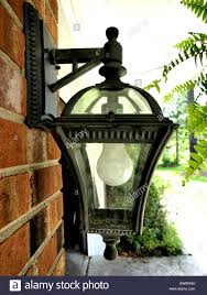 outdoor residential light fixture with white bulb in a metal black