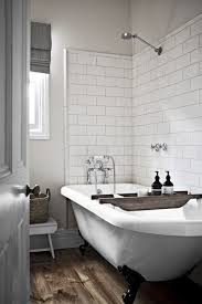 glossy white finish beveled ceramic subway tile bathroom with