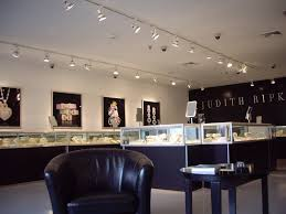 Fantastic Track Lighting And Glass Display Cases Using Chic LED Strip For Modern Jewelry Shop Design