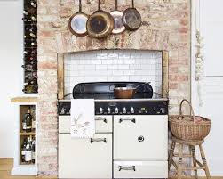 Rustic Kitchen Ideas With White Aga In Exposed Brick Chimney