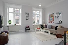 the simple eclectic living room features high ceilings and