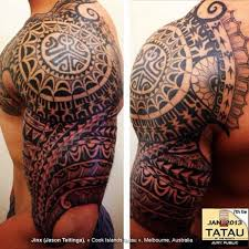 Maori Polynesian Tattoos On Chest And Left Sleeve Photo
