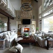 Living Room With Stone Fireplace Two Country 2 Tier Iron Candelabra Chandelier Rustic