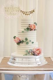 Rustic Buttercream Wedding Cake With Sugar Roses Wax Flower And Greenery Topped Hessian Bunting