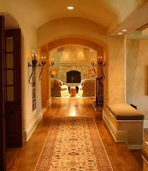 traditional hallway design with vintage wall sconces for dramatic