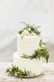 White Buttercream Wedding Cake With Ferns