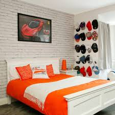 White Teenage Boys Bedroom With Cap Wall Display Formula 1 Poster And Exposed Brick