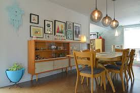 Midcentury Hutches Placed Next To One Another Double Up The Dining Room Storage Space