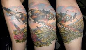 Canadian Tattoo Artists Prefer Subjects Like This Colourful Calf Of A Pair Spitfires In Flight Over Field Poppies