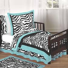 Master Bedroom Design With Turquoise Border For Zebra Print Bed Cover And Door Mat