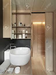 nahaufnahme waschbecken in einem modernen badezimmer mit holz schiebetür und holzverkleidung