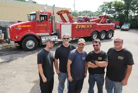 Brockton Tow Operator Describes Wet And Wild Job - News - The ... Lynch Truck Center Chicago Tow Wrecker Or Car Carrier Waterford Fills Your Commercial Fleets Needs Miller Industries Trucks By Used Rollback For Sale Ford And More Welcome To World Towing Recovery New 2018 Kenworth T800 With Vulcan V70 35 Ton Near Intertional 4300 Wi 02505147 Artstation Vintage John Maurcio Pictures Of Best Inc 7335 W 100th Pl Bridgeview Il Dealersnew Service And Parts Youtube