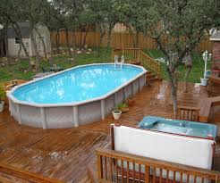 Best Swimming Pool Deck Ideas Makeovers Above Ground | TimedLive.com Decorating Attractive Above Ground Pool Deck For Enjoyable Home Good Picture Of Backyard Landscaping Decoration Using White Latest Ideas On Design Inspiring And 40 Uniquely Awesome Pools With Decks Pools Beautiful Oval Designs Gardens Geek Modern Image Solid Above Ground Pool Landscaping Ideas Swimming Spa Best And Emerson