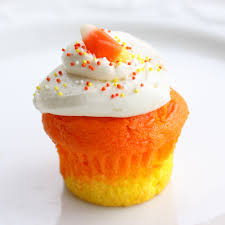 Candy Corn Cupcakes a doctored cake mix makes these super moist candy corn colored cupcakes