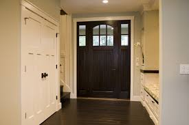 This Lovely Foyer Utilizes Dark Wood To Ground The Small Space A Built In