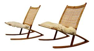 1950s Mid-Century Modern Frederik Kayser Rocking Chairs - A Pair Havana Cane Sofa Cushion Vintage Birdseye Maple Rocking Chair Woven Seat Sewing Mid Century Danish Modern Rope Wegner Pair Of Chairs Rosewood Carved With Cane Weaving Vti Chennai Antique Woven Rocking Chair Butter Churn On Wooden Malawi White Mid Century Arthur Umanoff Cord Rope Wicker Rocker Rustic Primitive Armchair Glider Seating Rattan Shabby Chic Coastal Country French Nursery Old Wooden Isolated Stock Photo