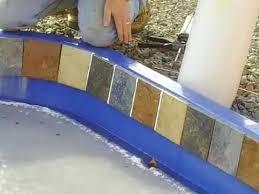 installing waterline tile on a fiberglass pool