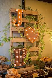This Rustic Wedding Dessert Table Display Is Perfectly Accented By Huge Marquee Letters