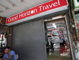 A Thai People Sits In Front Of Grand Horizon Travel Agent Office Pattaya Chonburi