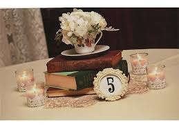 Old Hardcover Books Stacked On Top A Vintage Style Doily And Surrounded By Votive Candles With Wedding CenterpiecesCenterpieces