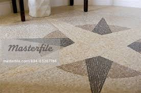 mosaic tile compass design on floor detail stock photo