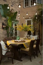 Architectural Detail Combined With Wicker And Iron Create Eclectic Outdoor Dining Space I Love The Pops Of Yellow As Well String Lights