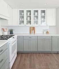 White Upper Cabinets Caesarstone Quartz In Pure Countertop Grey Lower
