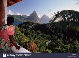 100 J Mountain St Lucia Woman Enjoying View Of The Pitons From Hotel Room Balcony