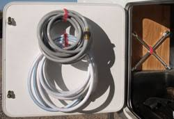 Hang Your RV Hoses To Make Extra Space In Outside Storage