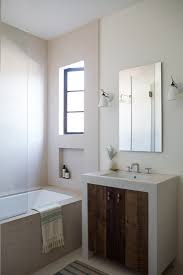 Remodeling 101: How To Install Flattering Lighting In The Bathroom ... Superior Haing Bathroom Mirror Modern Mirrors Wood Framed Small Contemporary Standard For Bathrooms Qs Supplies High Quality Simple Low Price Good Design Mm Designer Spotlight Organic White 4600 Inexpensive Spectacular Ikea Home With Lights Creative Decoration For In India Ideas William Page Eclipse Delux Round Led Print Decor Art Frames