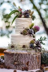 Carrot Cake With Cream Cheese Frosting On A Tree Trunk Slab Decorated Wildflowers