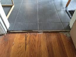 tile to wood floor transition doorway tile floor designs and ideas