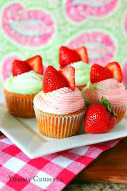 strawberry key lime cupcakes filled with key lime pie filling and topped with strawberry and lime