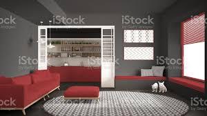 minimalistisches wohnzimmer mit sofa großem runden teppich und küche im hintergrund graurot moderne innenarchitektur stockfoto und mehr bilder