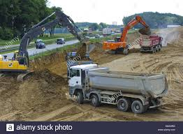 Trucks And Diggers At Road Construction In Germany Stock Photo ... Toy Truck Videos For Children Bruder Backhoe Excavator Top Ten Legendary Monster Trucks That Left Huge Mark In Automotive Or Rent Used Bucket Boom Pssure Diggers And Grave Digger Stock Photos Intertional Derrick Kentucky For Sale Florida Sago Mini Android Apps On Google Play Cstruction 12 Volt Ride On Baby Drakes Whlist And Dumper Standing Idle A Building Site Rural Pennsylvania 1995 Ford Fseries Awd Single Axle Sale By