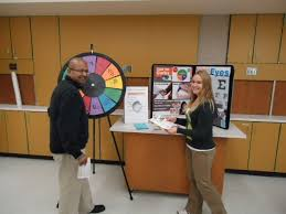 Game Wheel And Poster With Dietetic Student Educator