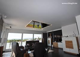 spanndecke wohnzimmer schwarz glänzendes element ciling