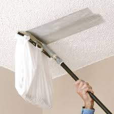 Skip Trowel Over Popcorn Ceiling by You Can Attach A Plastic Bag To This Popcorn Ceiling Scraper From