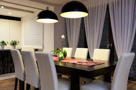 Clean White Walls And Airy Curtain Panels Are Perfect For This Transitional Dining Room That Features A View To The Lake Look Is Grounded By Dark