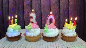 Happy Birthday Concept Cupcakes Number Thirty Candles Wooden Background Stock Video