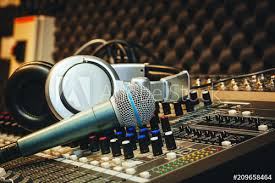 Close Up Instruments Music Background ConceptSingle Microphone With Headphones On Sound Mixer Board In