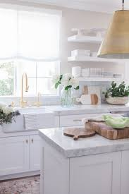 White Kitchen Ideas Pinterest by 12 Photo Of White Kitchen Cabinets With White Marble Countertops