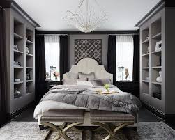 White Bed With Gray Quilt And Shams